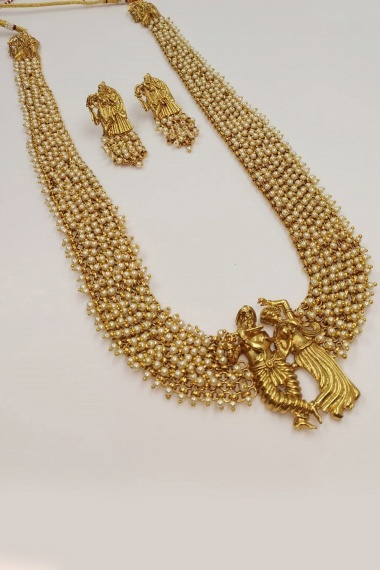 Golden Traditional White Beaded Necklace Set with Radha Krishna Pendant