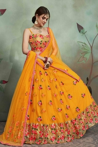 Mustard Yellow Net Designer Flared Lehenga Choli with Floral Embroidered Butta and Sequinned Border