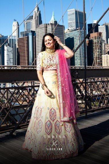 Light Yellow Organza Multi Colored Embroidered Lehenga Choli with Applique Work