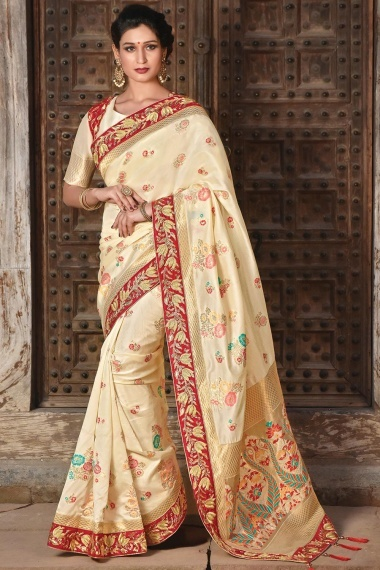 Cream Silk Floral Woven Saree with Tassels and Embroidered Jacket Blouse