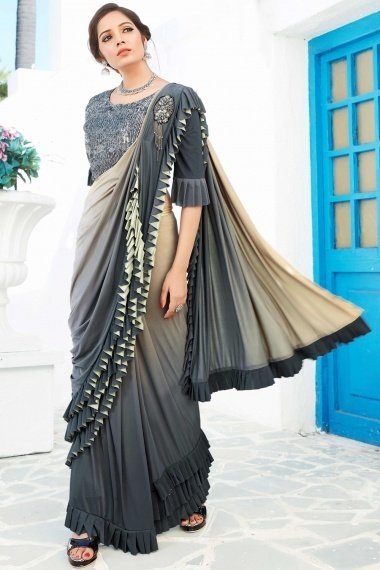 Grey and Beige Shaded Lycra Tiered Ruffle Saree with Handworked Patch and Designer Blouse