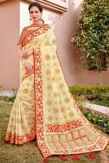 Cream Silk Woven Saree with Red Border and Double Blouse