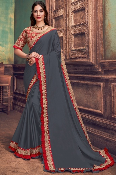 Grey Georgette Silk Plain Saree with Contrast Frill Border and Designer Blouse