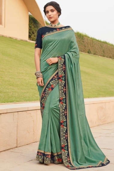 Sage Geen Silk Plain Saree with Blue Embroidered Border