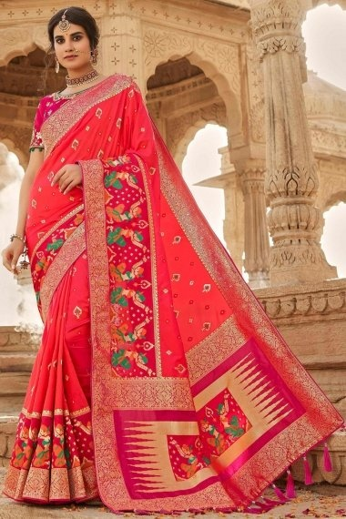 Coral Pink Silk Traditional Woven Saree with Human Inspired Motifs Border